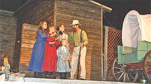 Only a 45-minute drive east of Springfield, Mo. (on hwy 60), come and experience the past with Laura Ingalls Wilder as she reminisces about her childhood pioneer days, her incredible family, and her beloved Almanzo. Laura's life unfolds through a live theater production that culminates on that momentous day in 1951 when Mansfield dedicated its library in her honor. Laura's Memories captures Mrs. Wilder's journeys through Iowa, Minnesota, the Dakota Territory, Kansas, and finally Mansfield, Missouri where Laura and Almanzo spent their remaining years. Come and celebrate the life of Laura Ingalls Wilder as the Ozark Mountain Players bring history to life under the starry canopy of the Ozark sky. This unforgettable musical production is performed in a comfortable amphitheater dedicated to the enduring memory of one of America's favorite authors, Laura Ingalls Wilder. 